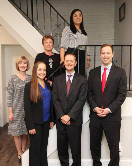 Smith Law Offices staff standing on a stairwell.